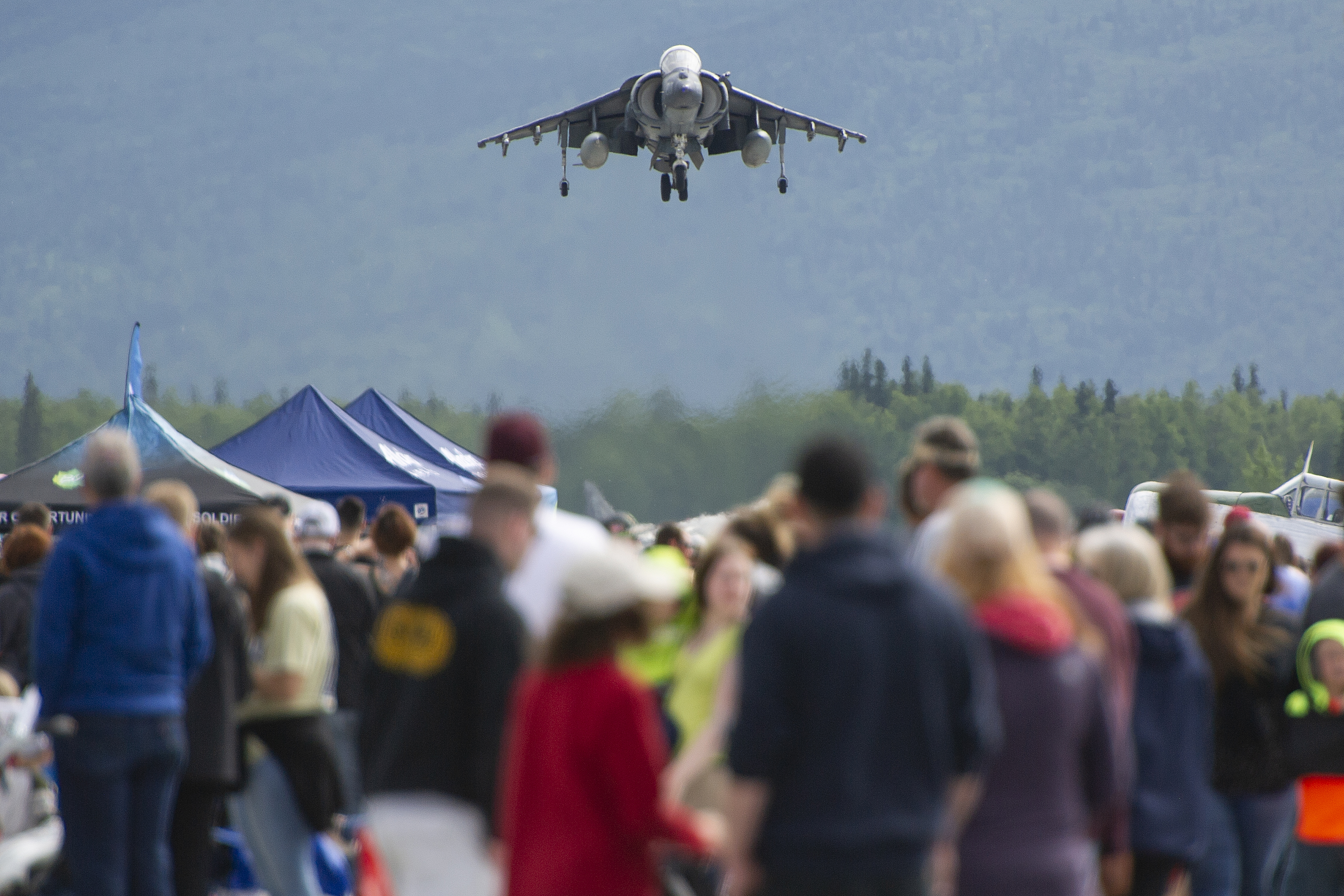 A U.S. Marine Corps. AV8B Harrier lands in front of the crowd during the Arctic Thunder Open House, June 30, 2018. This biennial event hosted by Joint Base Elmendorf-Richardson, Alaska, is one of the largest in the state and one of the premier aerial demonstrations in the world. The event features multiple performers and ground acts to include the JBER joint forces, U.S. Air Force F-22, and U.S. Air Force Thunderbirds demonstrations teams, June 30-July 1. (U.S. Air Force photo by Justin Connaher)
