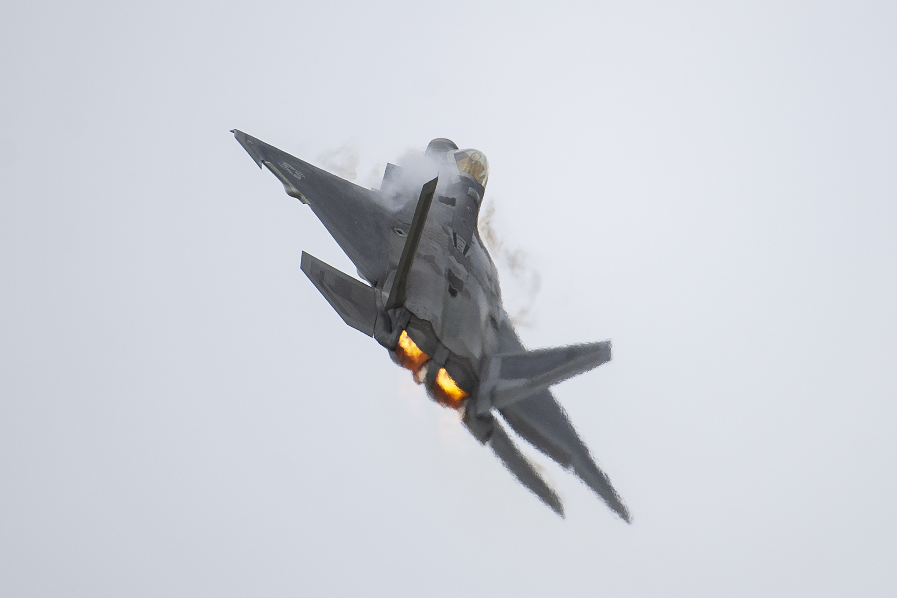 An F-22 Raptor makes a high-speed pass showcasing the Air Combat Command F-22 Demonstration Team during the Special Needs and Department of Defense Family Day at the Arctic Thunder Open House, June 29, 2018. This biennial event hosted by Joint Base Elmendorf-Richardson, Alaska, is one of the largest in the state and one of the premier aerial demonstrations in the world. The event features multiple performers and ground acts to include the JBER joint forces, U.S. Air Force F-22, and U.S. Air Force Thunderbirds demonstrations teams, June 30-July 1. (U.S. Air Force photo by Justin Connaher)