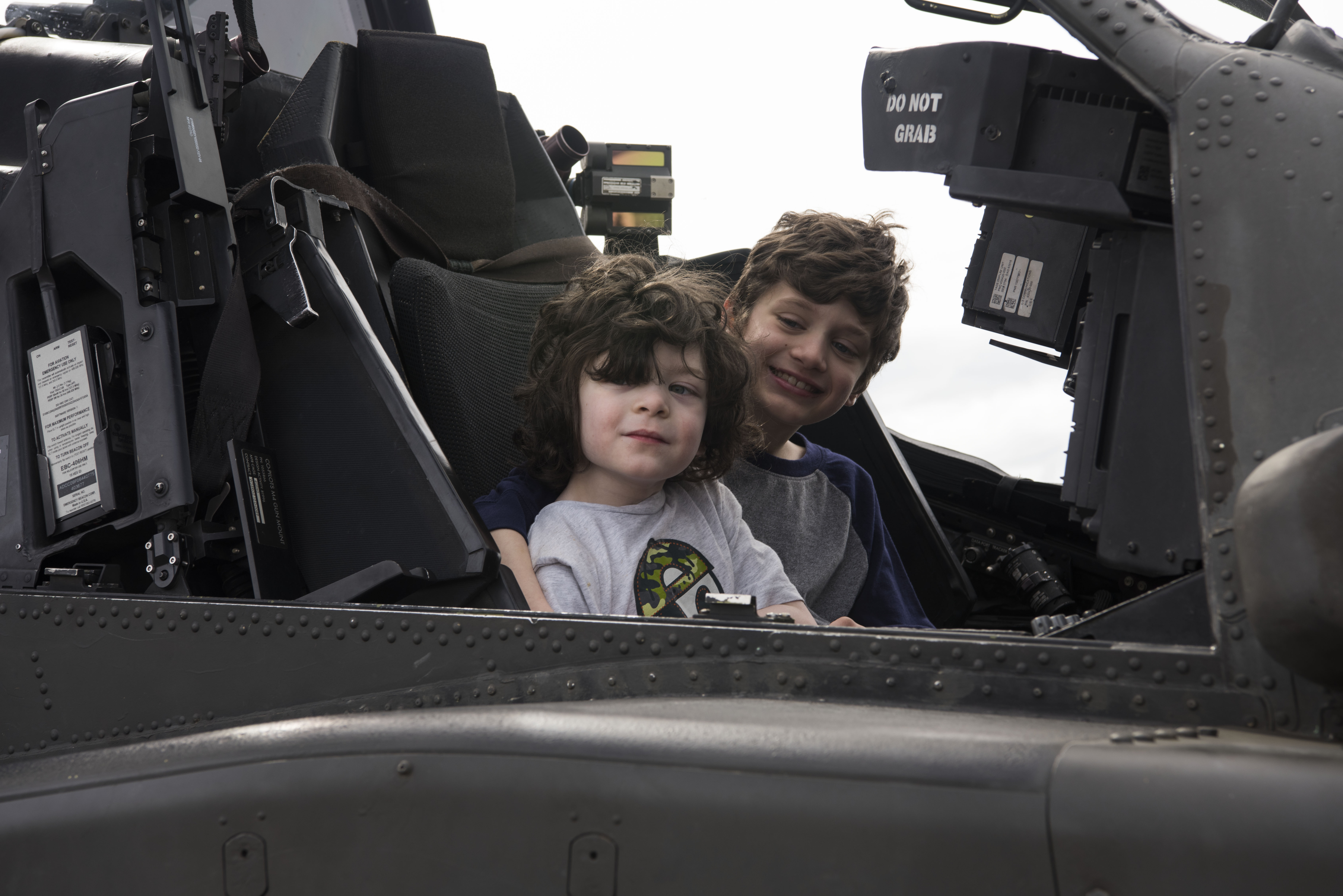 Liam Newbury, 5, and Payton Newbury, 8, sons of U.S. Air Force Master Sgt. Ryan Newbury, 732nd Air Mobility Squadron maintenance operations center superintendent, smile during the Arctic Thunder Open House Special Needs and Department of Defense Family Day at Joint Base Elmendorf-Richardson, Alaska, June 29, 2018. During the biennial open house, JBER opens its gates to the public and hosts multiple performers including the U.S. Air Force Thunderbirds, JBER Joint Forces Demonstration and the U.S. Air Force F-22 Raptor Demonstration Team. (U.S. Air Force photo by Airman 1st Class Jonathan Valdes Montijo)