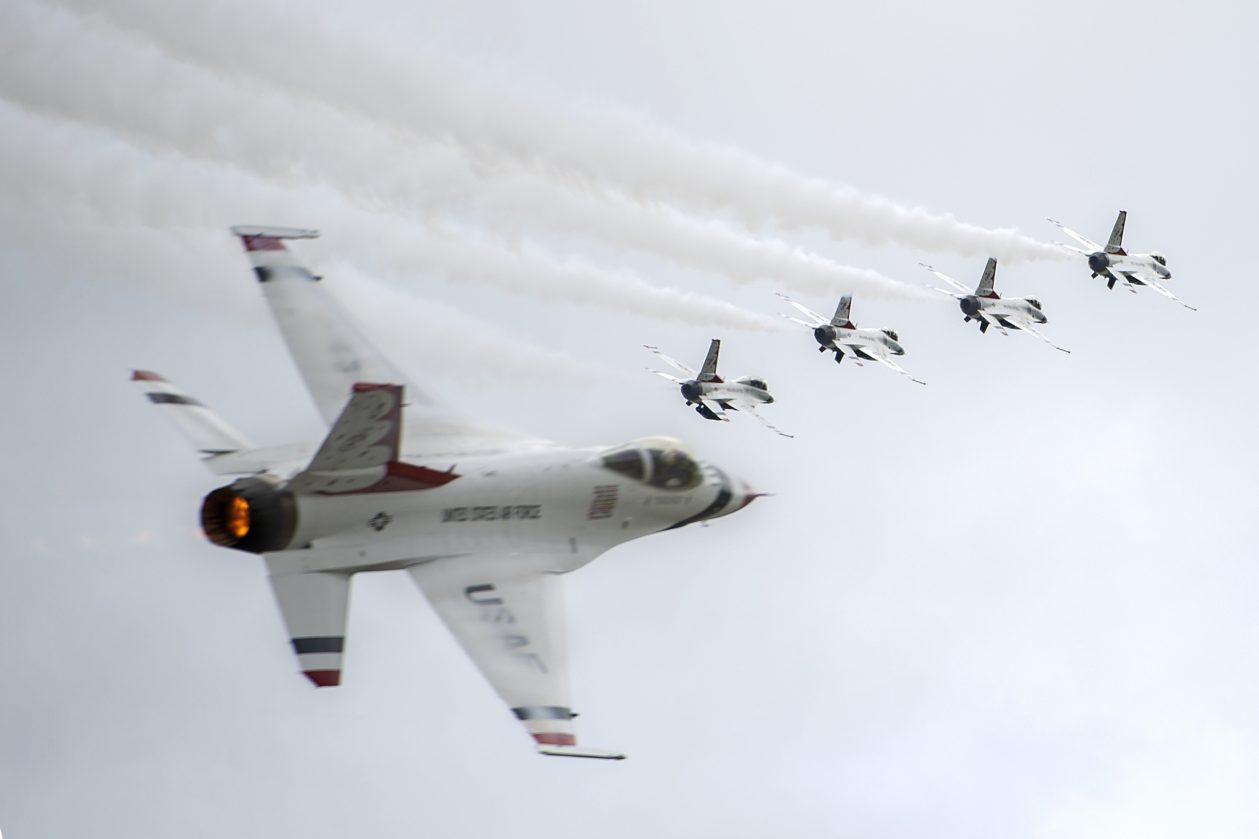 The U.S. Air Force Thunderbirds perform during the Special Needs and Department of Defense Family Day at the Arctic Thunder Open House, June 29, 2018. This biennial event hosted by Joint Base Elmendorf-Richardson, Alaska, is one of the largest in the state and one of the premier aerial demonstrations in the world. The event features multiple performers and ground acts to include the JBER joint forces, U.S. Air Force F-22, and U.S. Air Force Thunderbirds demonstrations teams, June 30-July 1. (U.S. Air Force photo by Justin Connaher)