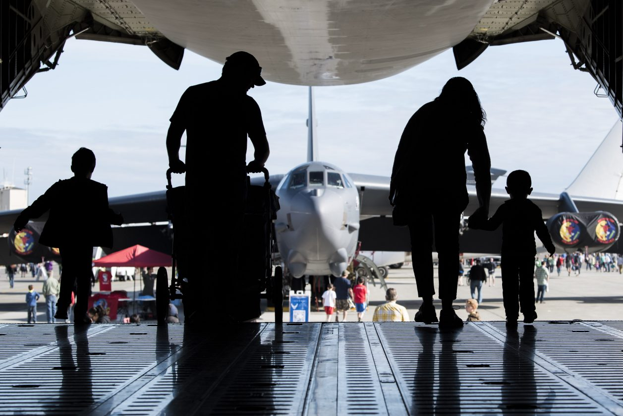 A family exits a U.S. Air Force C-5 Galaxy static display during the Arctic Thunder Open House on Joint Base Elmendorf-Richardson, Alaska, July 1, 2018. During the biennial open house, JBER opens its gates to the public and hosts multiple performers including the U.S. Air Force Thunderbirds, JBER Joint Forces Demonstration and the U.S. Air Force F-22 Raptor Demonstration Team. (U.S. Air Force photo by Airman 1st Class Caitlin Russell)