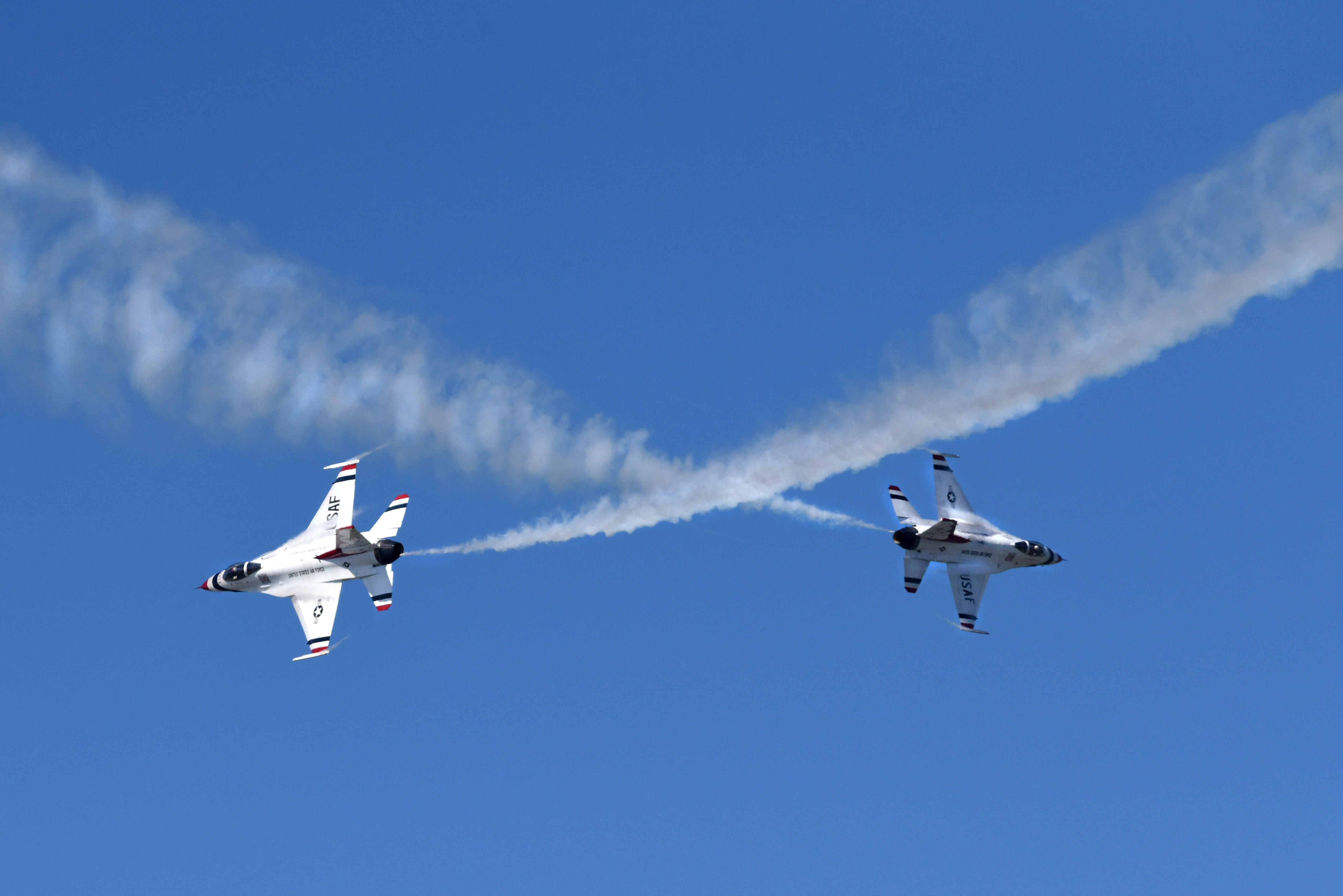 The U.S. Air Force Thunderbirds Demonstration Team performs during the Arctic Thunder Open House at Joint Base Elmendorf-Richardson, Alaska, July 1, 2018. This biennial event hosted by JBER is one of the largest in the state and one of the premier aerial demonstrations in the world. The event features multiple performers and ground acts to include the JBER Joint Forces, U.S. Air Force F-22 and U.S. Air Force Thunderbirds demonstrations teams, June 30-July 1. (U.S. Air Force photo by Jamal Wilson)