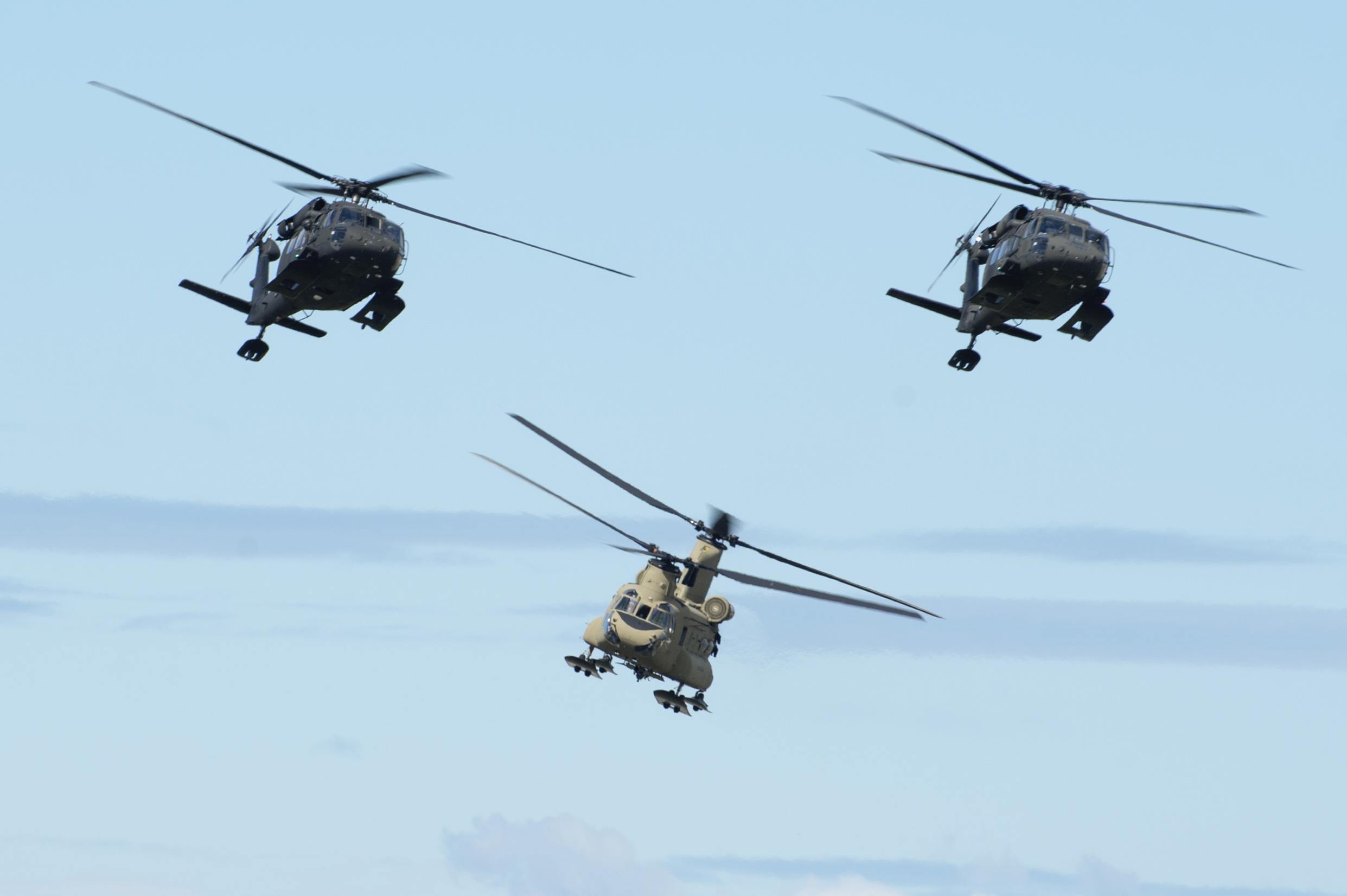 Two Alaska Army National Guard UH-60 Black Hawks and a U.S. Army Alaska CH-47 Chinook approach the flight line as part of the Joint Forces Demonstration during the Arctic Thunder Open House at Joint Base Elmendorf-Richardson, Alaska, July 1, 2018. This biennial event hosted by JBER is one of the largest in the state and one of the premier aerial demonstrations in the world. The event features multiple performers and ground acts to include the JBER joint forces, U.S. Air Force F-22 and U.S. Air Force Thunderbirds demonstrations teams, June 30-July 1. (U.S. Air Force photo by Alejandro Peña)